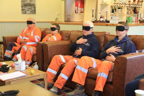 Hope Cement Works employees, meditating at the works mind matters day.